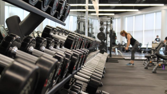 woman working out in gym facilities